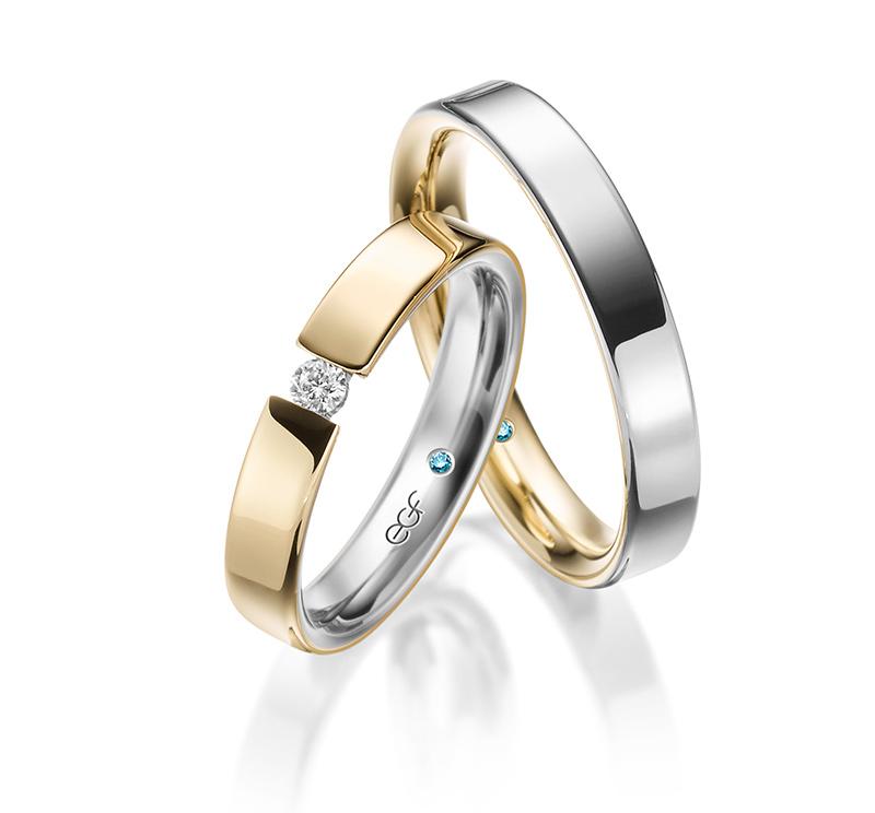 Trauringe Silber und Gold mit einem Stein